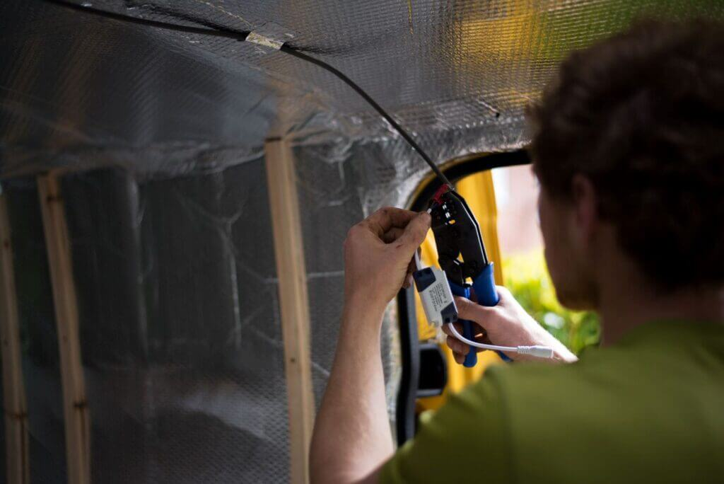 using a crimping tool to connect campervan electrical system