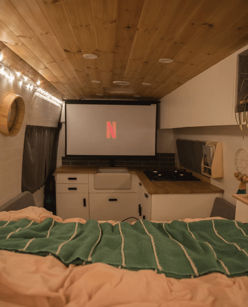 campervan projector screen setup van life watching netflix